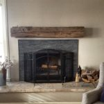 dark grey reclaimed wood fireplace