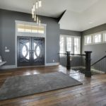 Stairwell with weathered antique reclaimed wood flooring