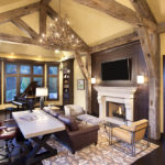 Living area with fireplace and hand hewn timbers