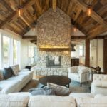 Living room with fireplace mantel and hand hewn timbers