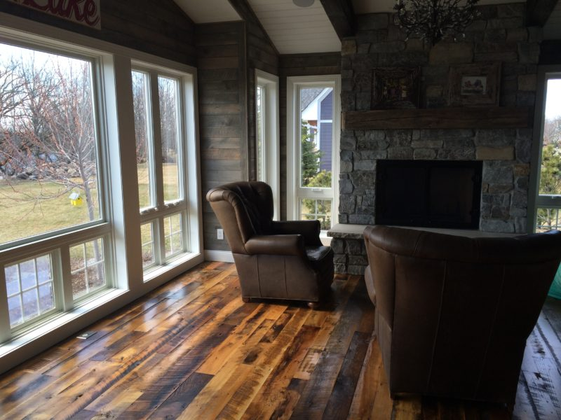 Living area with mixed reclaimed wood flooring